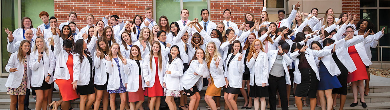 MUSC College of Pharmacy students in white coats